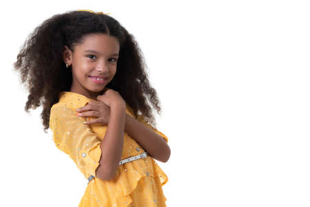 Portrait of a cute multiracial small girl with beautiful curly hair - Isolated on white