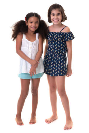 Two friendly small girls, friends or sisters  - Hispanic and african-american - Isolated on white
