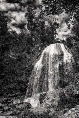The Soroa waterfall among lush tropical vegetation in Cuba. Black and white image Standard-Bild