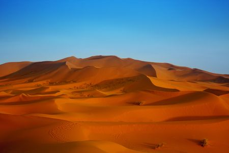 desert footprint: sunset over Sahara desert (Morocco) Stock Photo