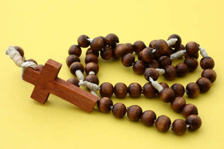 wooden rosary on yellow Stock Photo - 289159