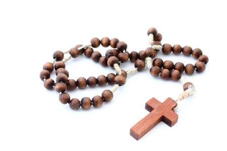 sacrosanct: wooden rosary  on white