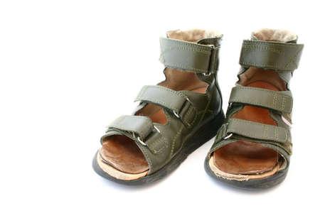 orthopaedic: used childrens orthopaedic sandals on white background