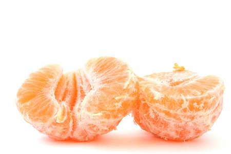 peeled tangerines on white photo