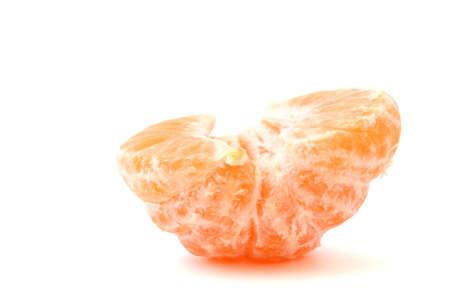lonely peeled tangerine on white photo