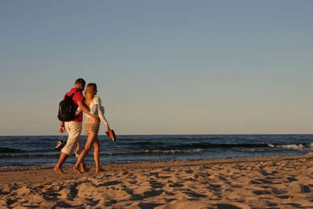 stroll: couple during a beach stroll