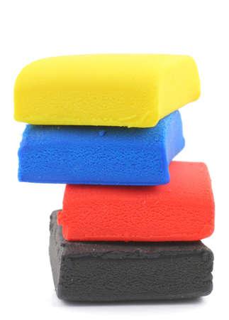 playdoh: pile of colorful plasticine blocks on white