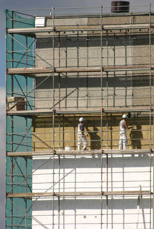 insulate: Workers on a scaffold