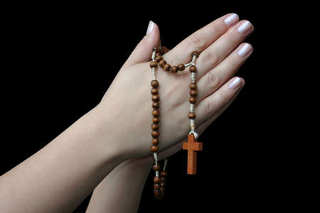 devout: praying with a rosary Stock Photo