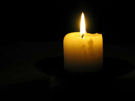 murk: candle in dark Stock Photo
