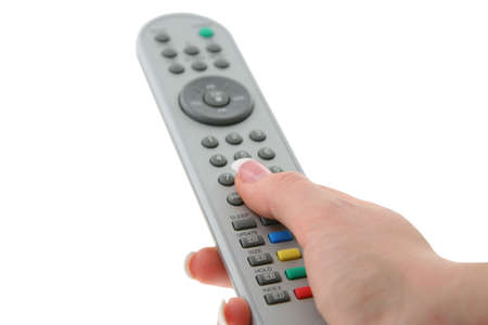 female hand with remote control photo