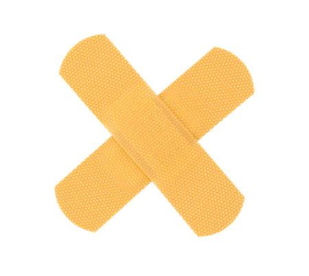 bandaid cross on pure white background photo