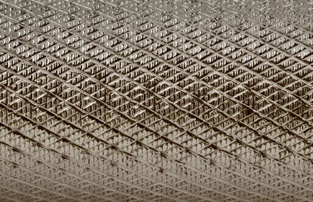 grooved: grooved metal surface #2 - light sepia tones Stock Photo