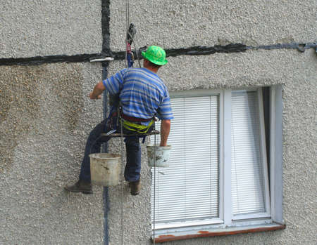 block of flats: renovation worker on a block of flats #2 Stock Photo