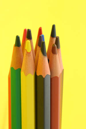 bunch of colorful pencils on yellow background #2 photo