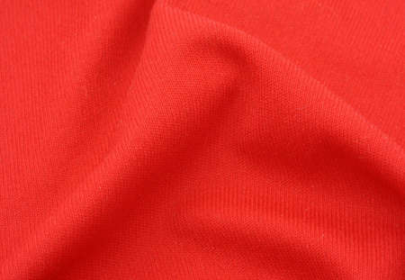 cotton fabric: red cotton fabric with crease Stock Photo