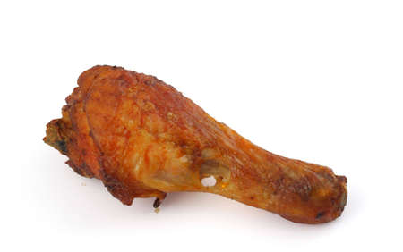 fried chicken leg on white background photo