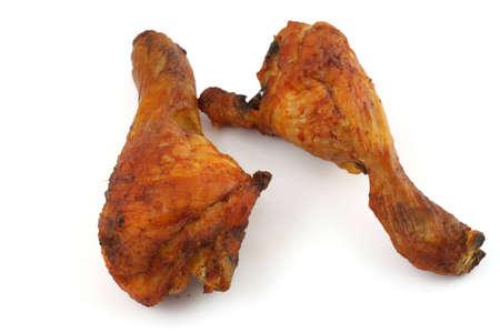 fried chicken legs on white background photo