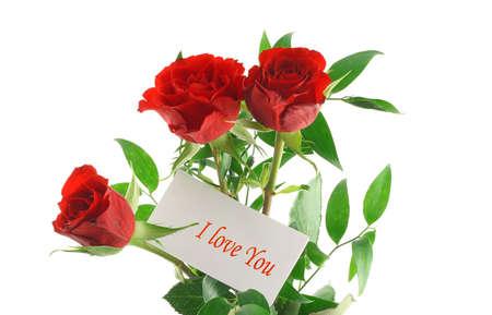te amo: tres rosas rojas con Te quiero mensaje  Foto de archivo