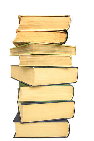 homestudy: stack of yellowed books on white background