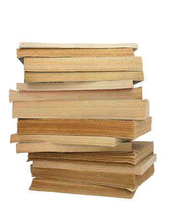yellowed: stack of yellowed books on white background