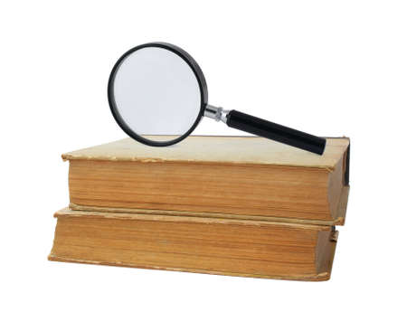 two old books and magnifying glass on white photo