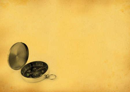compass against retro background photo