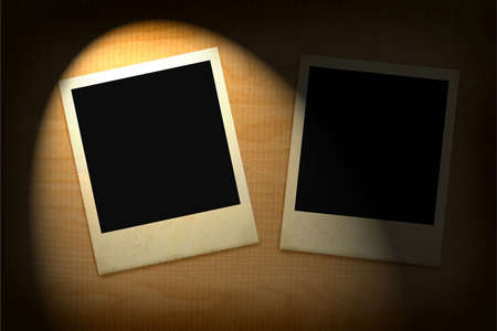 old photo: two old photo frames lit in darkness