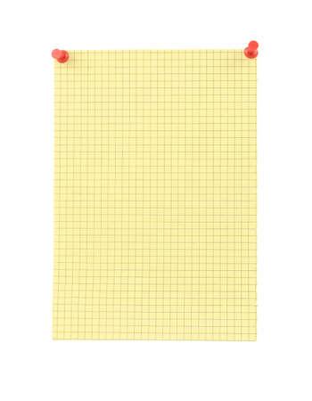 thumbtacked: yellow blank thumbtacked squared paper page Stock Photo