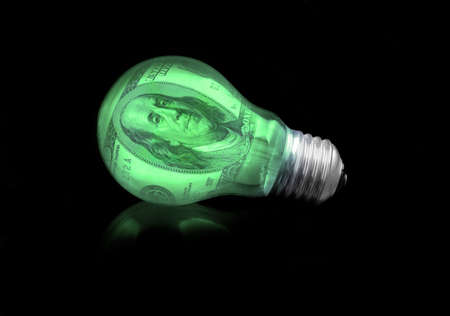 CONCEPT OF FINANCIAL IDEA -  LIGHT BULB Stock Photo