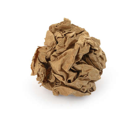 crushing: close-up of brown crumpled paper ball