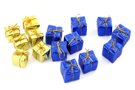 golden and blue gifts isolated on white photo