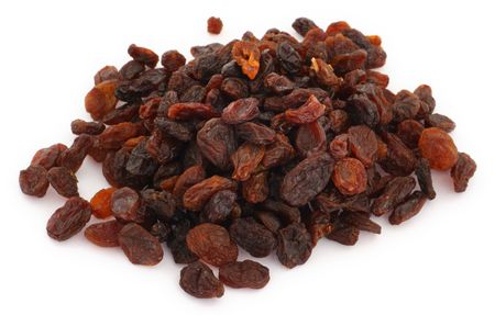 heap of delicious raisins isolated on white background
