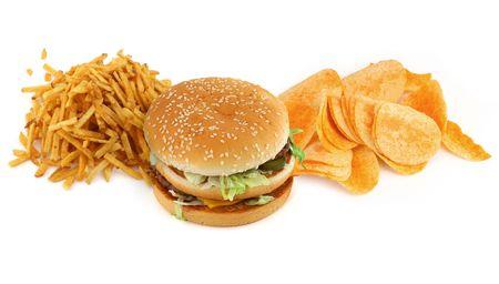 ongezond voedsel samenstelling tegen witte achtergrond Stockfoto