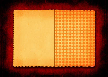 yellowed: yellowed paper with a squared part on red textile background