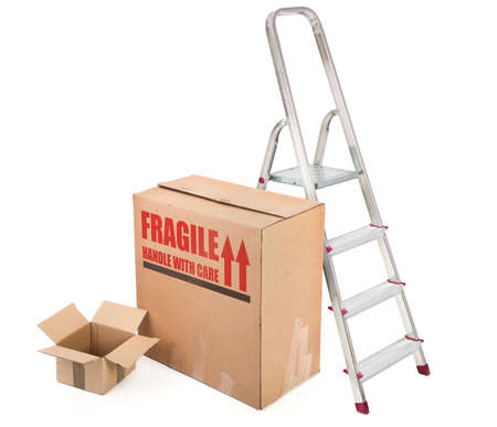 fragile cardboard boxes and ladder on white background photo