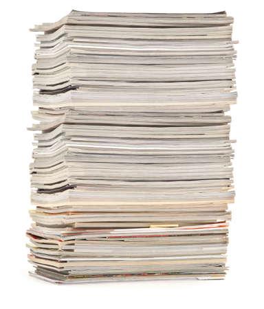 spoilage: large pile of colorful magazines isolated on white background