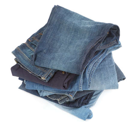 pile of blue jeans on white background photo