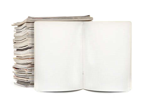 squared exercise book and magazines on white, visible natural shadow in front Stock Photo