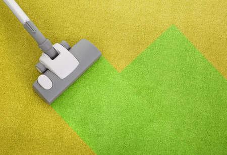 Staubsauger auf einem grünen Teppich