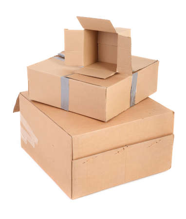 group of cardboard boxes againt white, gentle minimal shadow underneath Stock Photo - 4887927