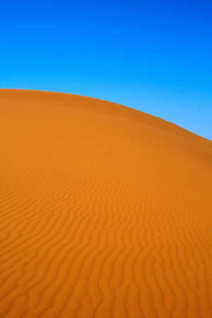 blissful: blissful view of sand dunes and cloudless sky, Erg Chebbi, Morocco  Stock Photo