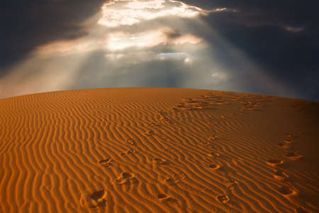 the sky split over the desert sand,  Erg Chebbi, Morocco   photo