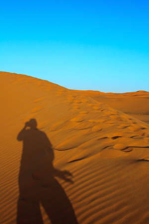 Photographer taking picture of a sand dunes Stock Photo - 5012192