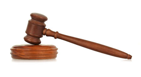 wooden gavel against white, small reflection in front  Standard-Bild
