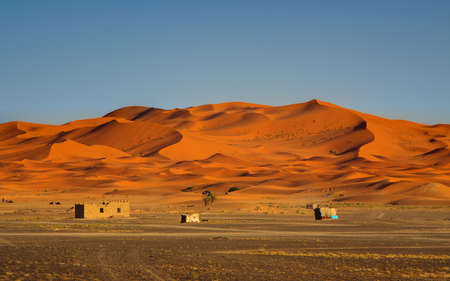 the day is coming to an end at the edge of the Sahara Desert (Erg Chebbi, Morocco) photo