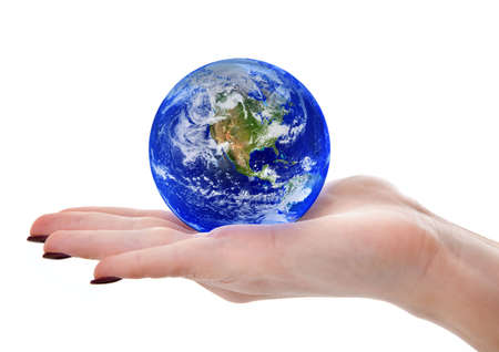spacial: female hand holding globe,  Earth image used courtesy of NASA Visible Earth http:www.visibleearth.nasa.govuseterms.php