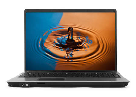 to watersplash: wide notebook with water splash wallpaper (photo inside is my property) Stock Photo
