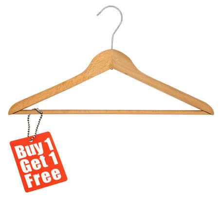 clotheshanger: coat hanger and sale tag on white background