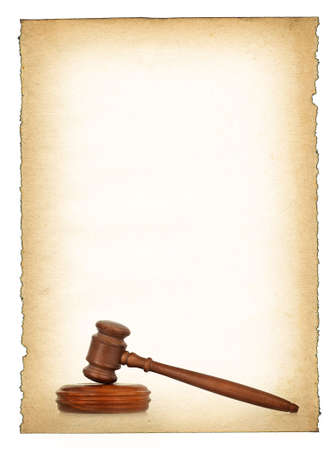 wooden gavel against old dirty paper background, all isolated on white, edges are very frayed photo